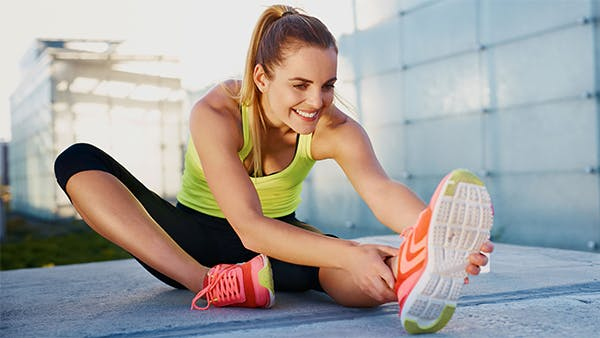 Healthy young woman stretching