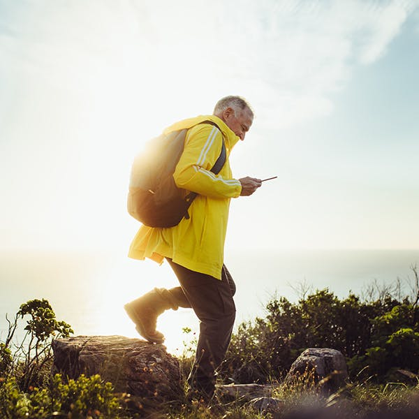 Person with a backpack hiking outside