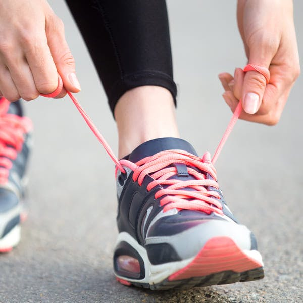 Woman tying shoelaces before running