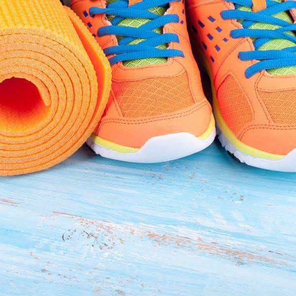 Orange yoga mat and sneakers