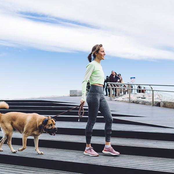 Woman walking her dog outside
