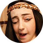 A young girl, inspired by King Tut, takes Buckley's. She makes a strange face after because of the taste.