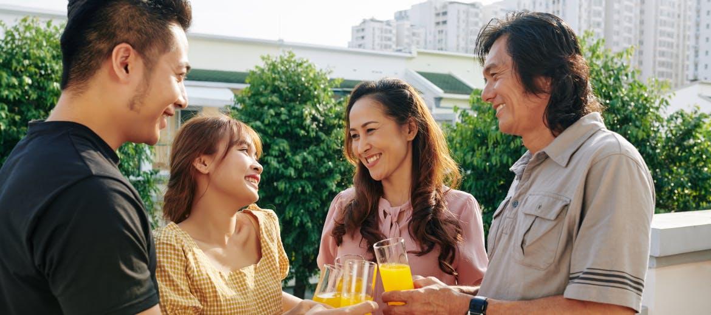 A group of friends drinking orange juice