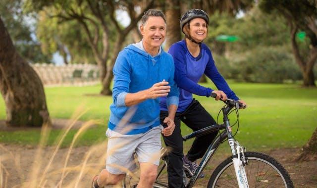 man and women enjoying outdoor activites with dentures
