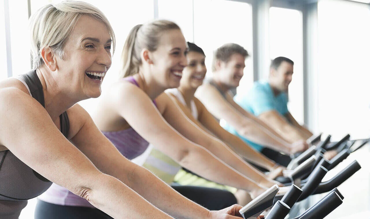 group excercising in a spin class
