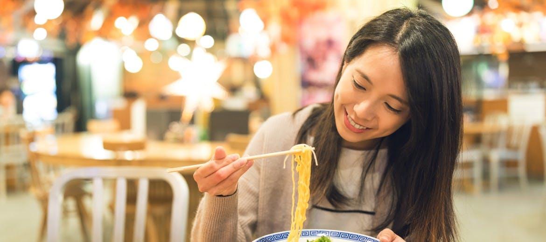 A women eating noodles