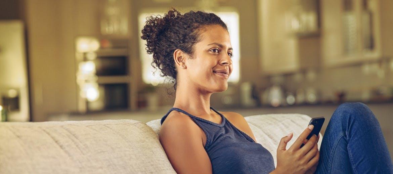A women sitting on a sofa