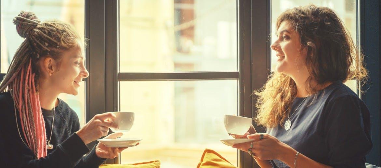 two women enjoying a coffee
