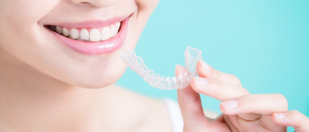 woman putting her retainer