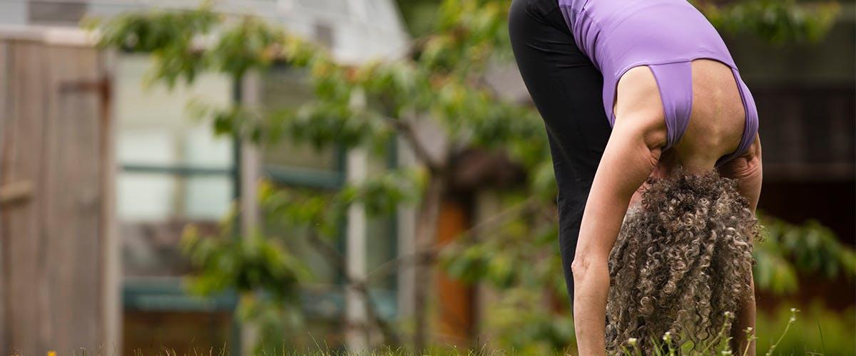 Forward Fold Yoga Pose Outdoors