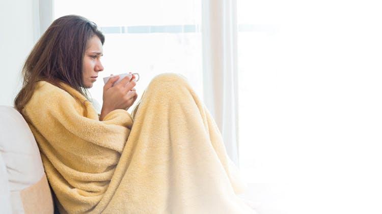 Woman blanket unwell