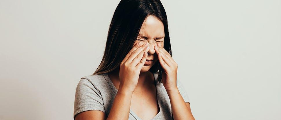 Woman suffering pain from sinusitis