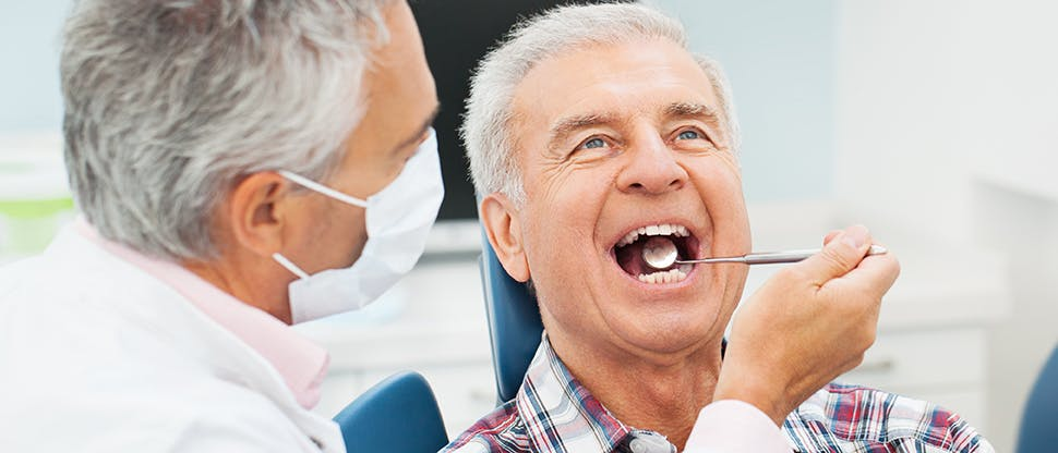 Dentist with senior patient
