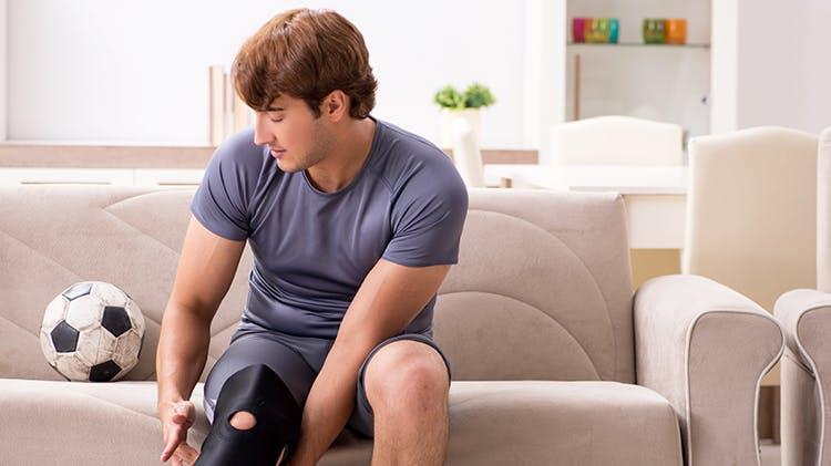 Man with knee brace