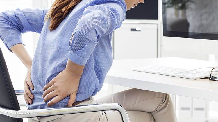 Business women with back pain