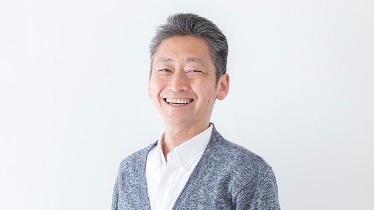 Grey-haired man smiling