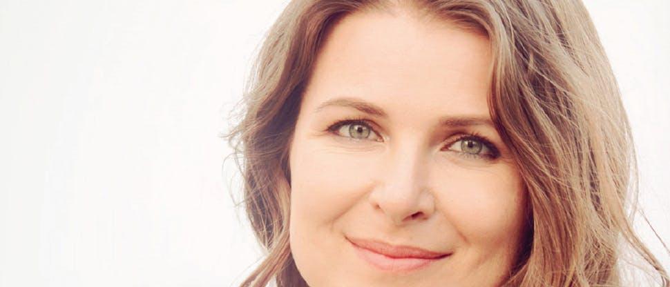 Woman facing camera and smiling