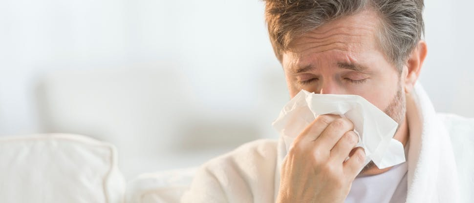 Person showing cold symptoms