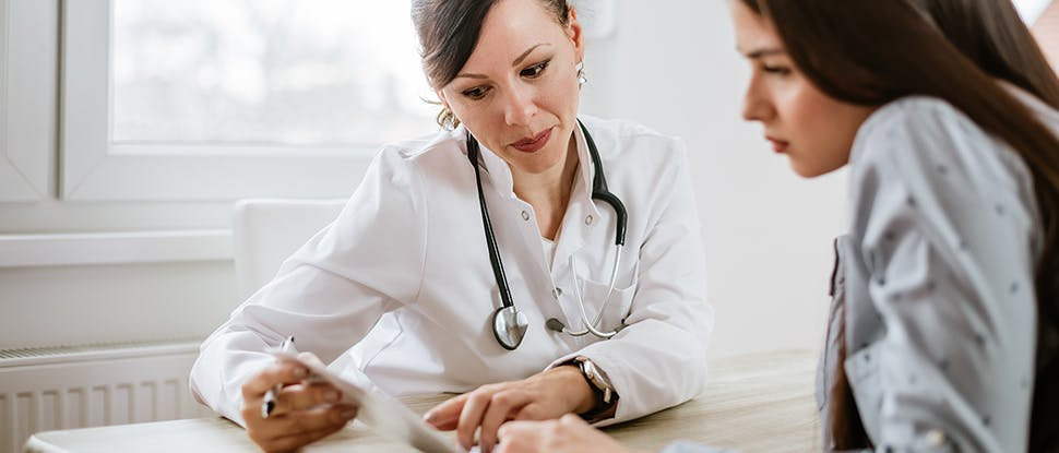 Healthcare professional and patient 1