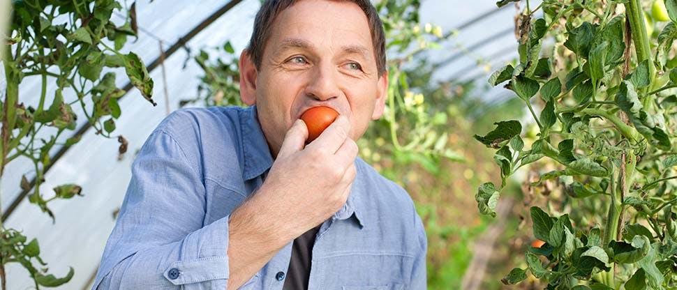 Man eating orange