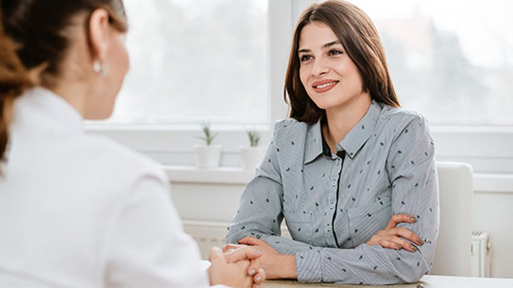 Women discussing with doctor