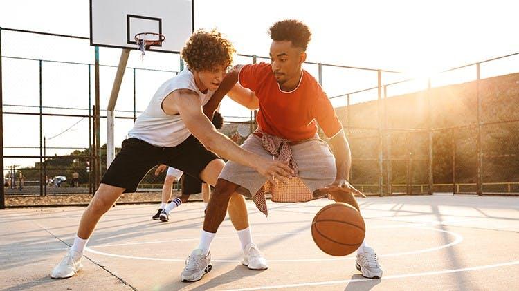 Young men playing basketball