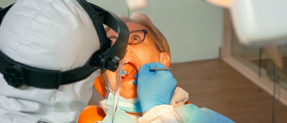 Dentist explaining gum disease to dental patient