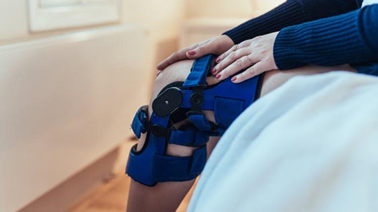 Woman with leg brace