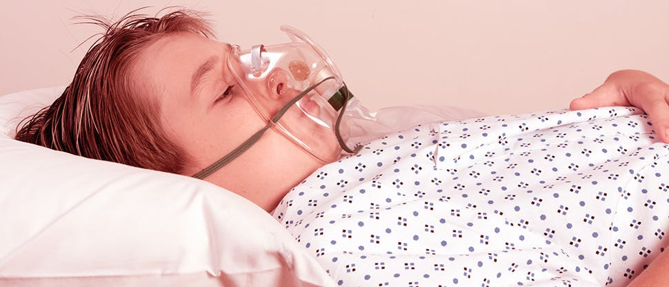 an-unwell-child-resting-wearing-a-patient