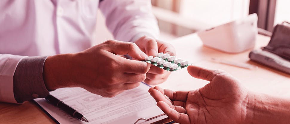 doctor-is-pointing-to-drug-tablet