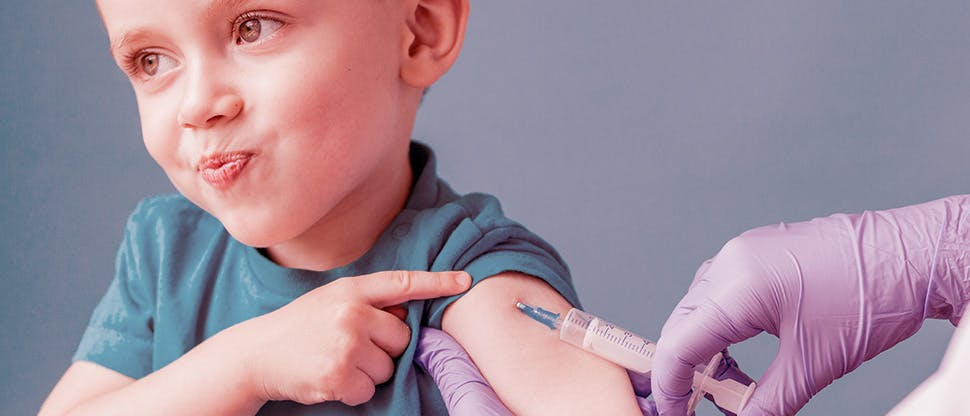 doctor-vaccinating-cute-little-boy