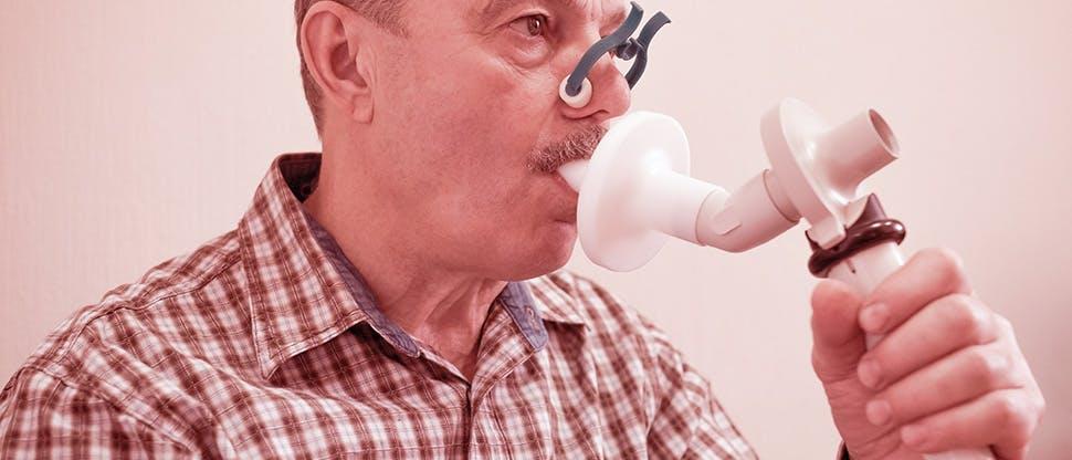 man-testing-breathing-function