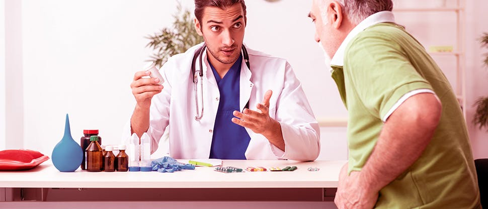 old-man-visiting-young-male-doctor-gastroenterologist