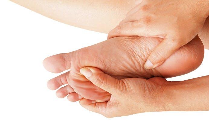 Hände halten Fuß barfuß Hintergrund