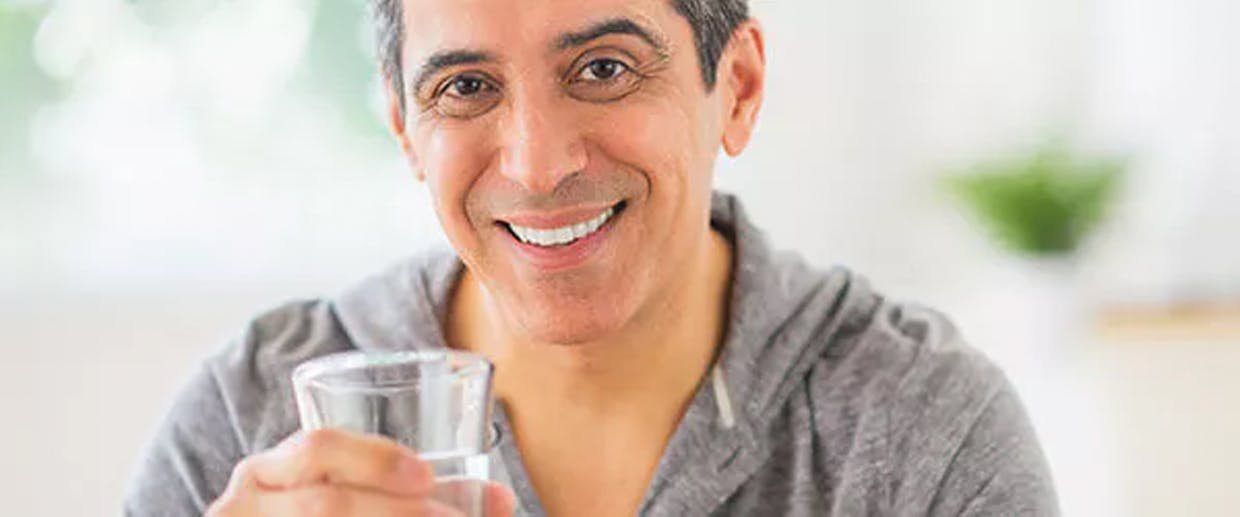 Man holding a glass of water