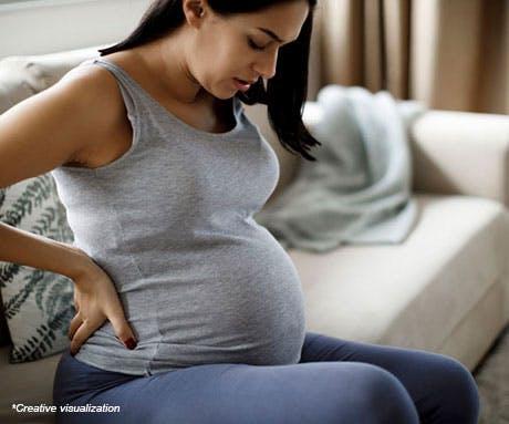 Pregnant woman in discomfort