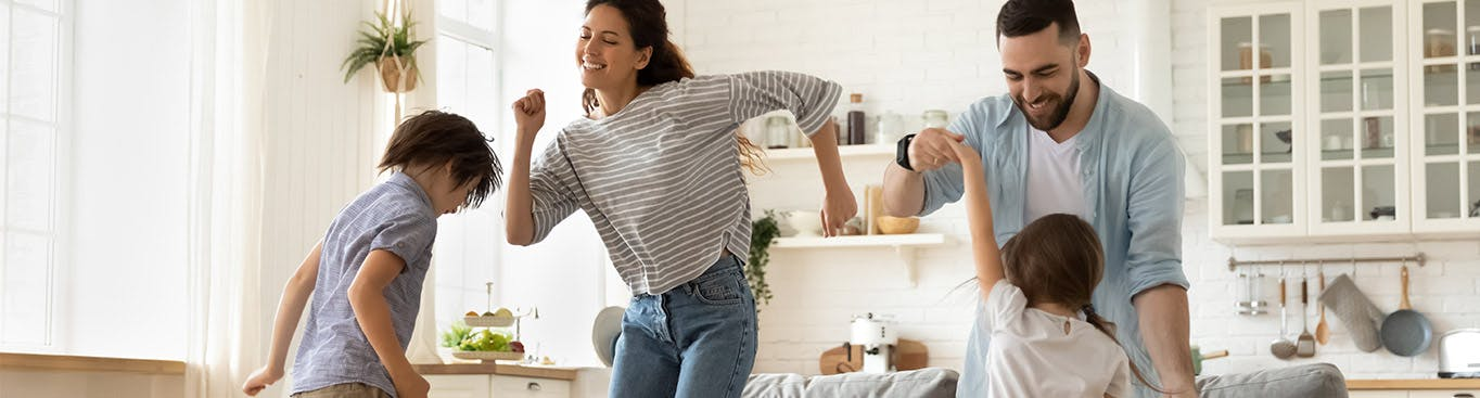 A family dancing at home
