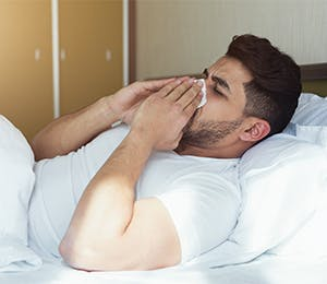 An ill man in bed