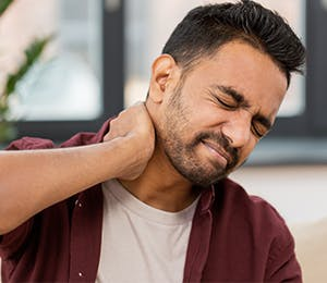 a man dealing with neck pain
