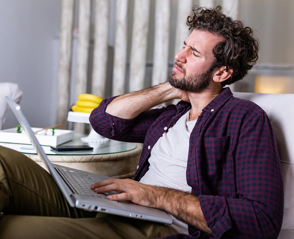 a man working and dealing with a neck pain