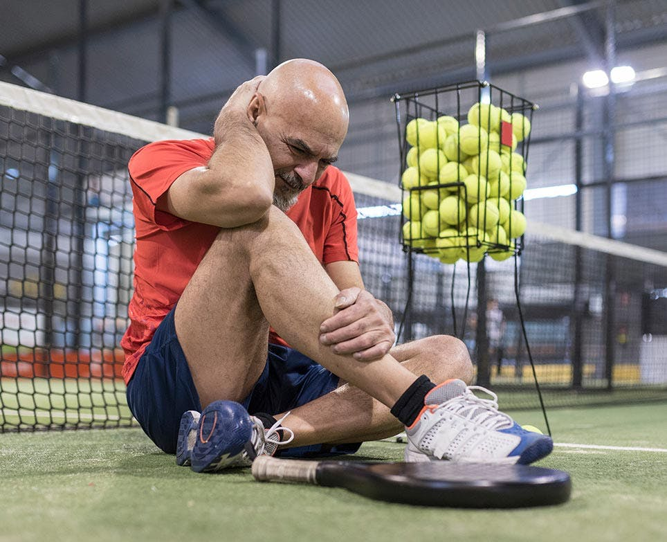 an athlete dealing with muscle aches