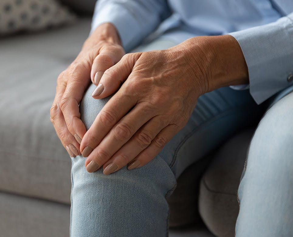 A person dealing with knee pain