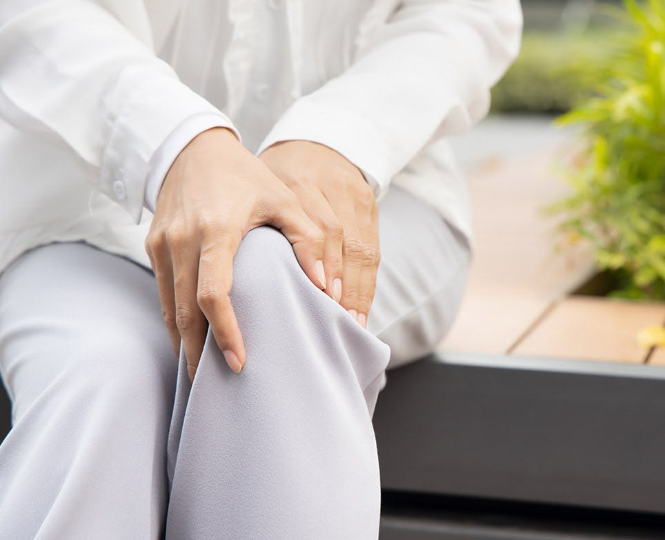 A person suffering from knee pain