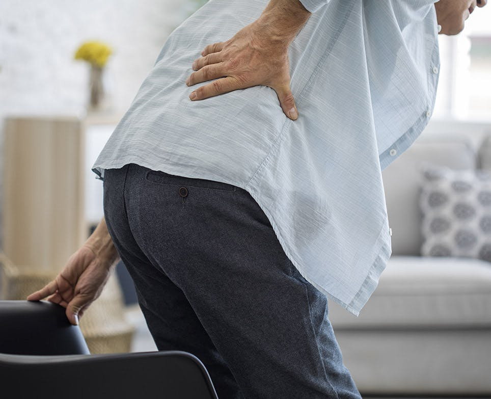 A man suffering from lower back pain