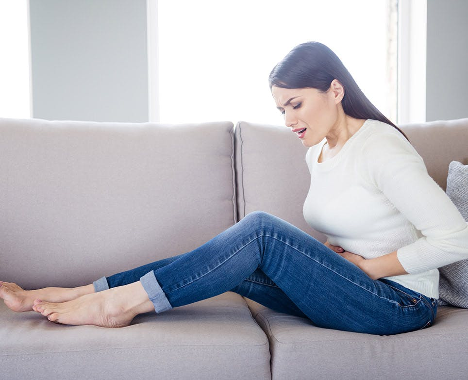 A woman dealing with menstrual cramps