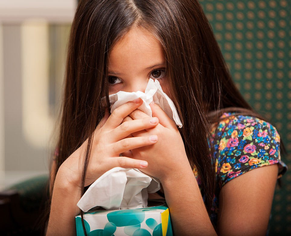 A girl suffering from a cold and a fever