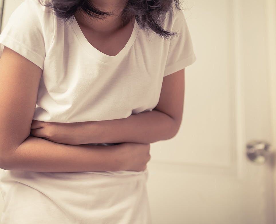 A girl suffering from a stomach ache