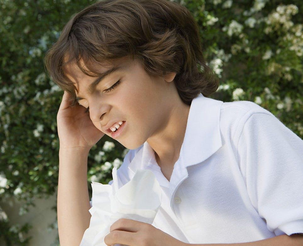 A kid dealing with a headache
