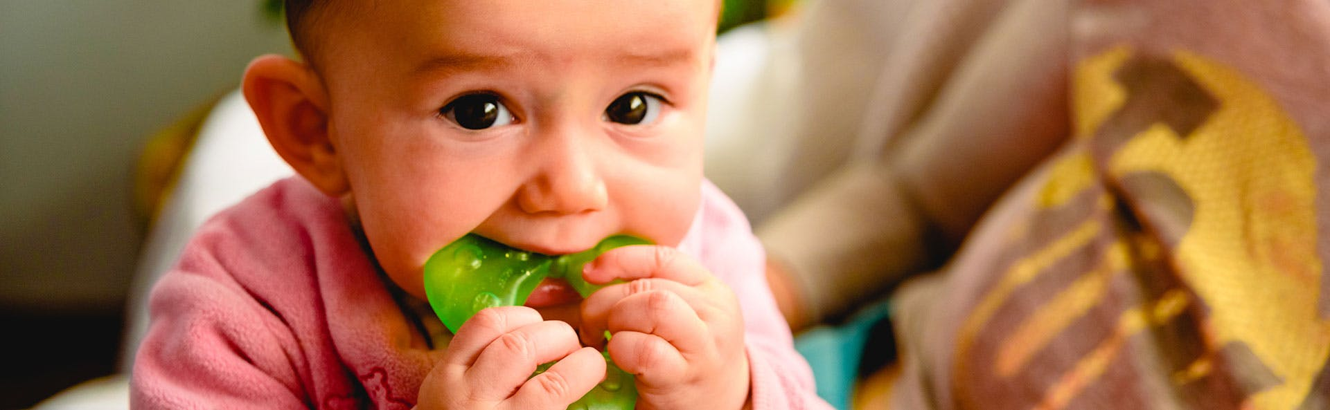 A baby using a teether