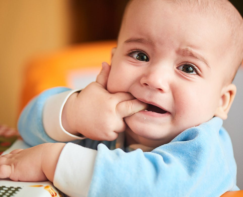A baby dealing with toothaches